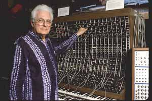 Robert Moog with Modular Synthesizer. It would fit on a credit card now.